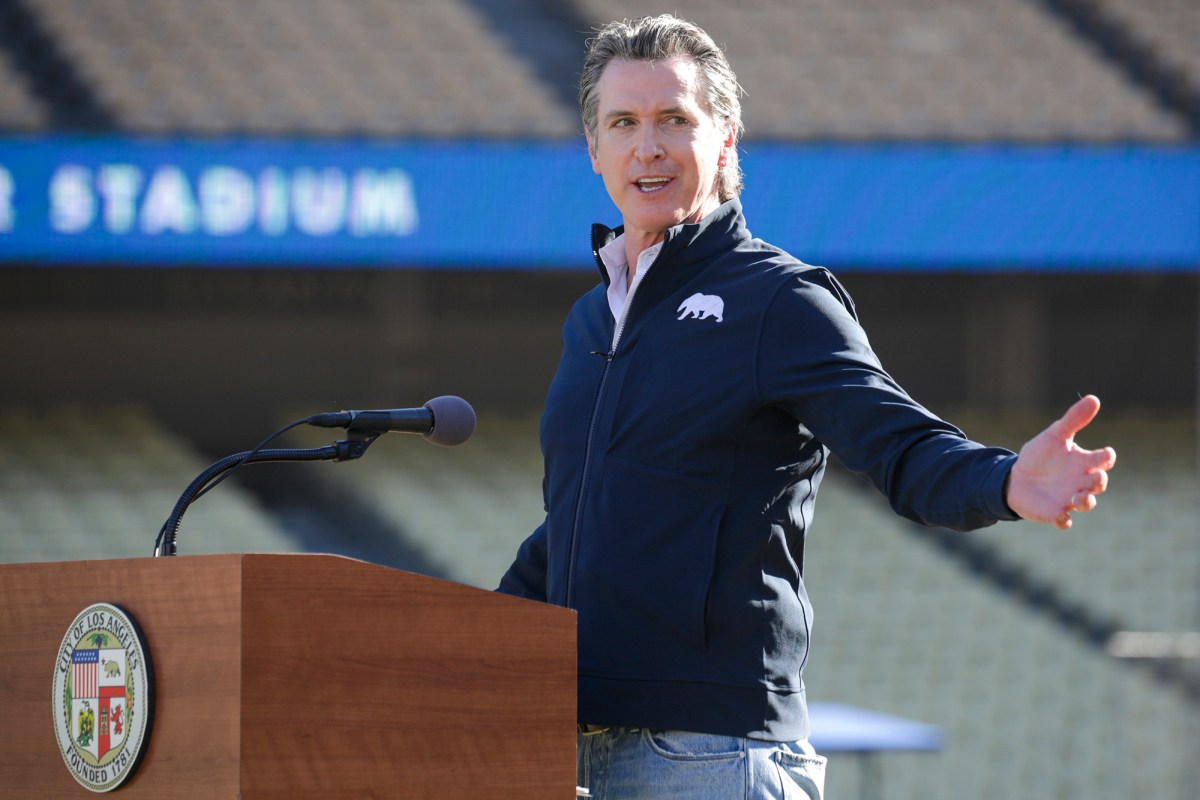 Governor Gavin Newsom addresses a press conference held at the launch of a mass COVID-19 vaccination site at Dodger Stadium in Los Angeles on Jan. 15, 2021. Photo by Irfan Khan, Los Angeles Times via AP/Pool
