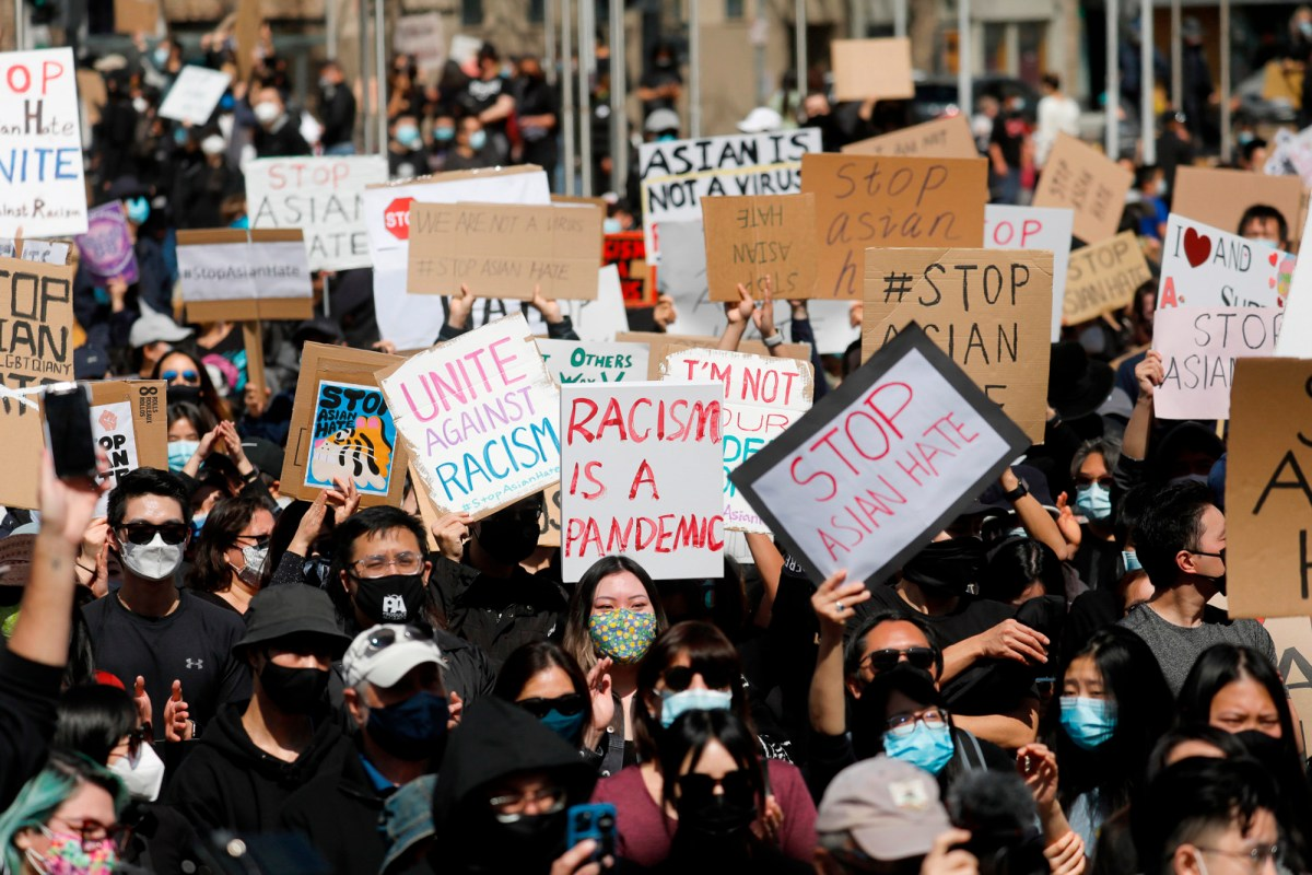 """Demonstrators attend the """"#StopAsianHate Community Rally"""" at San Jose City Hall Plaza in downtown San Jose on March 21, 2021. Recent incidents have prompted California lawmakers to urge an expansion of Californias hate crimes laws. Photo by Nhat V. Meyer, Bay Area News Group"""