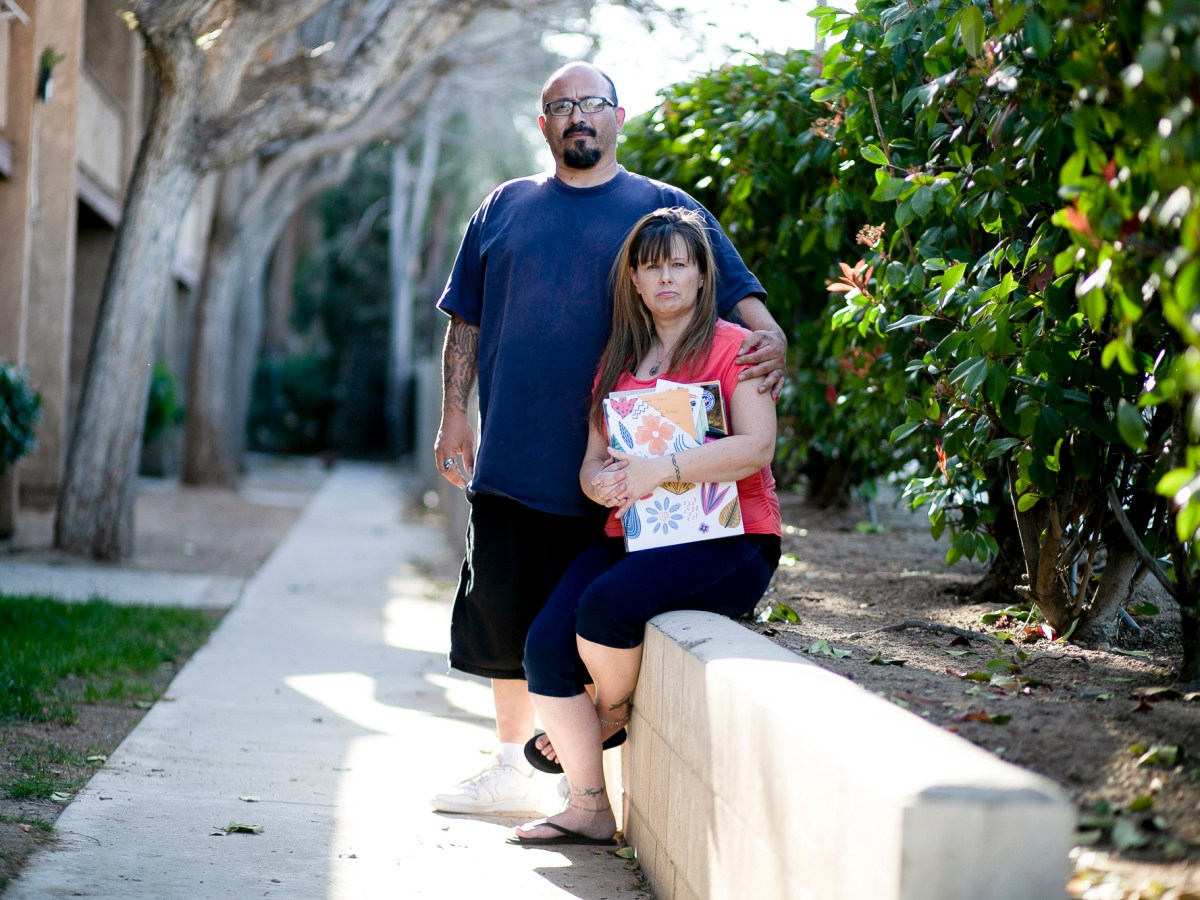 Stacy Lira and her husband, Armando, outside of their home in Victorville on March 29, 2021. Photo by Shae Hammond for CalMatters