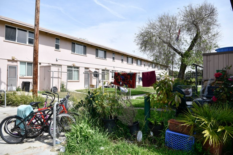 Residents' belongings behind apartment units at the Mar Vista Gardens public housing complex in Culver City on April 14, 2021. Photo by Pablo Unzueta for CalMatters