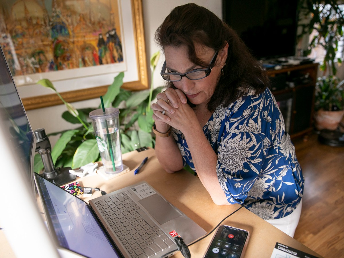 Alyssa Jenkins has a phone call with a person in search of a vaccine while using MyTurn at her Pacifica home on April 19, 2021. Jenkins has made appointments for more than 400 people since February. Photo by Anne Wernikoff, CalMatters