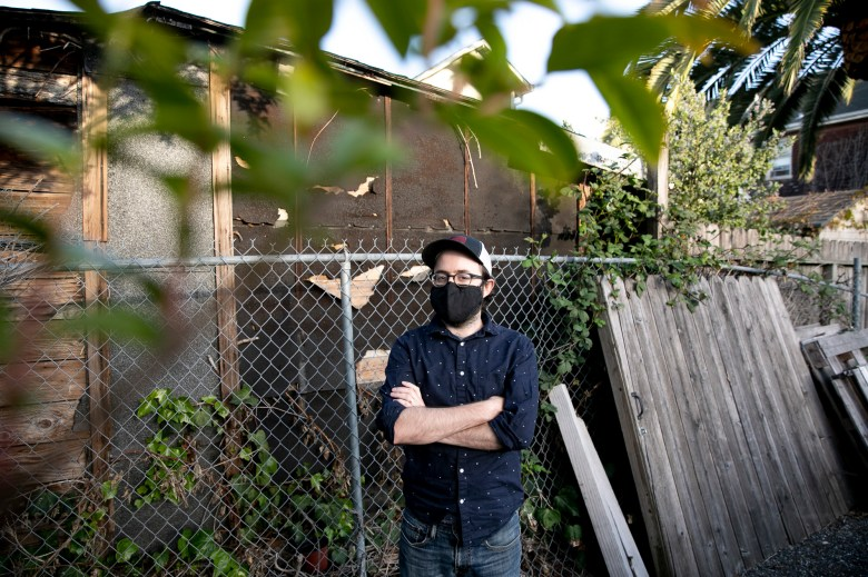 Ryan Furtkamp, who owes $25k in back rent but is ineligible for rent relief due to moving apartments, photographed at his Oakland home on April 20, 2021. Photo by Anne Wernikoff, CalMatters