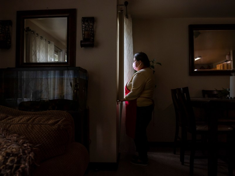 Blanca Esthela Trejo has foregone treatment for lingering pain caused by COVID-19 in order to prioritize paying rent on the apartment she shares with her family. Photo by David Rodriguez, The Salinas Californian