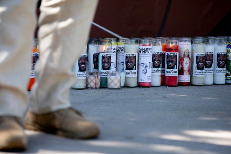 Prayer candles with Steven Taylor's face line the stage at a celebration of life held for Steven Taylor on the one-year anniversary of his death, at the San Leandro Marino on April 18, 2021. Photo by Anne Wernikoff, CalMatters