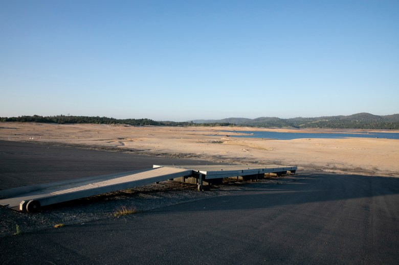 A boat ramp ends in the dry lakebed at Lake Folsom on April 22, 2021. The water level is currently at about 38% capacity. Photo by Anne Wernikoff, CalMatters