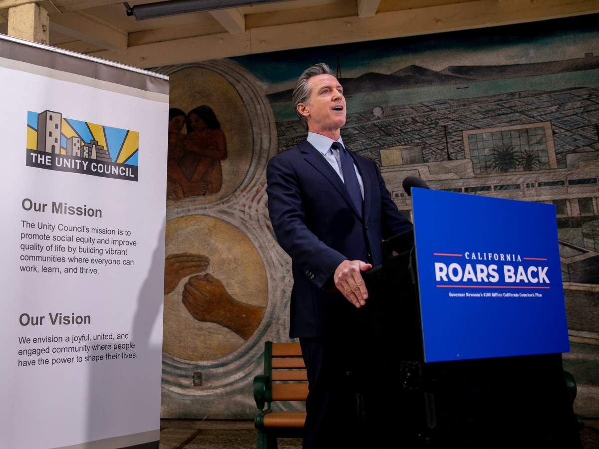 Gov. Gavin Newsom holds a press conference at The Unity Council in Oakland to announce an estimated $75.7 billion surplus and in addition to stimulus checks, tax rebates and additional rent relief on May 10, 2021. Photo by Anne Wernikoff, CalMatters