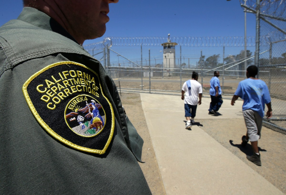 About 57% of staff in California prisons have skipped COVID vaccines. In this image from 2018, inmates pass a correctional officer as they leave an exercise yard at the California Medical Facility in Vacaville. Photo by Rich Pedroncelli, AP Photo
