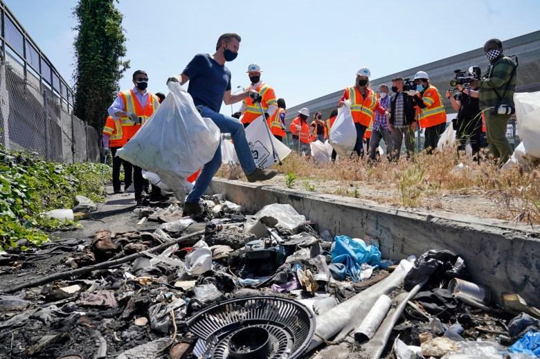 """Gov. Gavin Newsom joins a cleanup effort on May 11, 2021, in Los Angeles as part of his """"California Roars Back"""" budget tour. Photo by Marcio Jose Sanchez, AP Photo"""