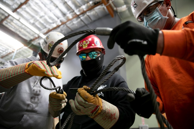 Apprentices sort through wire ropes called chokers at Iron Workers in Benicia on June 20, 2021. Photo by Anne Wernikoff, CalMatters