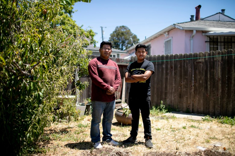 Eduardo with his father Emilio in the backyard of their home. Photo by Anne Wernikoff, CalMatters