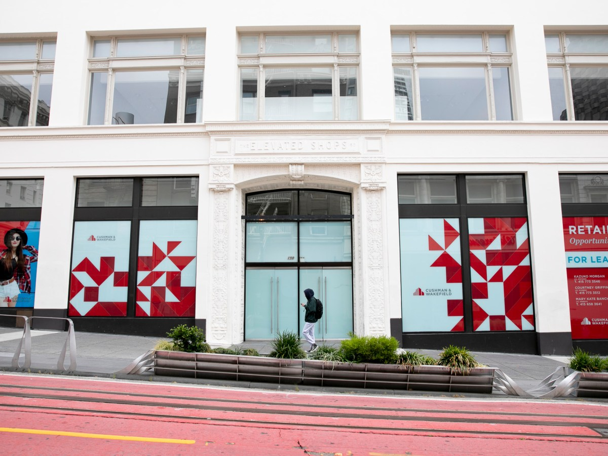 A pedestrian walks past a vacant store front on Powell Street in the Union Square shopping district in San Francisco on June 14, 2021. Photo by Anne Wernikoff, CalMatters
