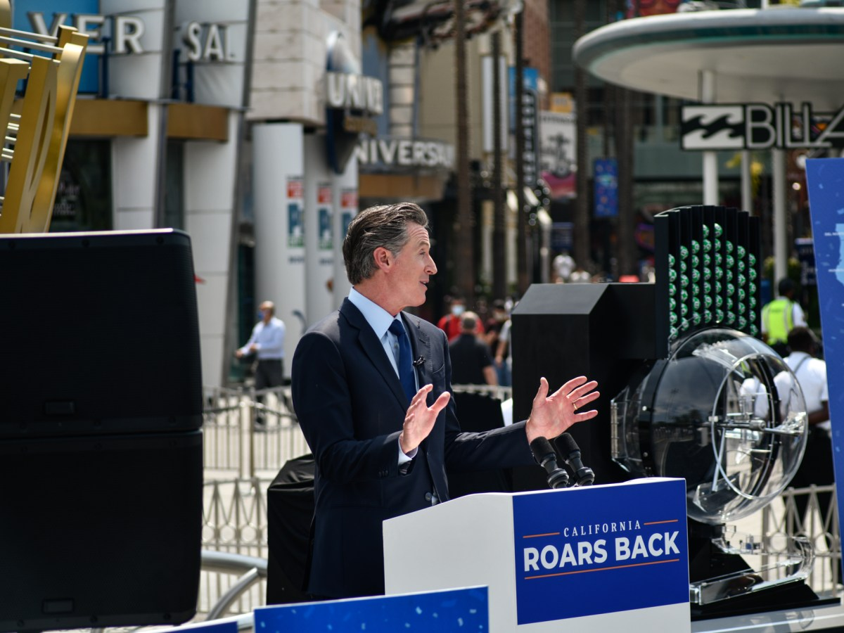 Gov. Gavin Newsom delivers a news conference at Universal Studios in Universal City, regarding California's coronavirus-related restrictions that were lifted on Tuesday, June 15, 2021. After 15 months, California's economy has fully reopened. Pablo Unzueta for CalMatters