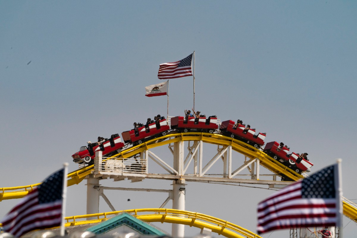 People ride the rollercoaster at Santa Monica Pier on May 29, 2021. Photo by Damian Dovarganes, AP Photo