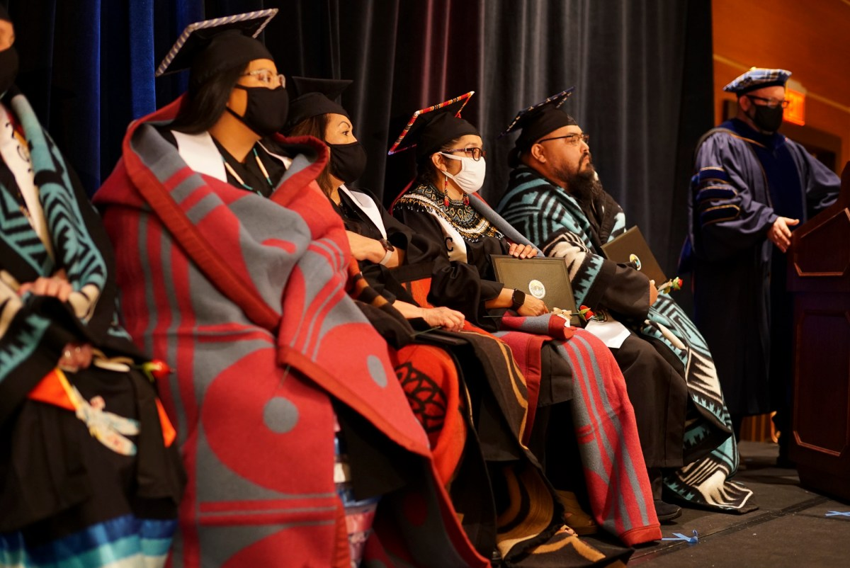Graduates on stage with speaker, Dr. T. Robert Przeklasa, Jr., during the first CINC commencement ceremony at Agua Caliente Resort Casino Spa Rancho Mirage on June 6, 2021. Photo by Eric Martinez courtesy of California Indian Nations College