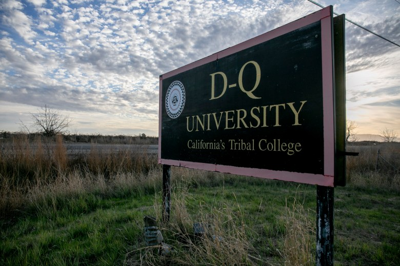 The sign for D-Q University remains standing along Country Road 31 in Yolo County on January 21, 2021. Photo by Anne Wernikoff, CalMatters