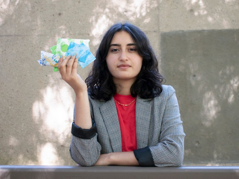 Menstrual activist and first year UCSC student Amanda Safi holds a menstrual cup from The Honey Pot Company. The Black-owned business is dedicated to menstrual health and hygiene. Photo by Lluvia Moreno for CalMatters College Journalism Network
