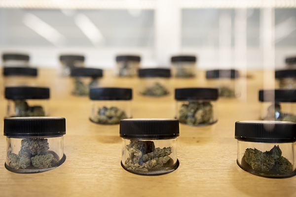 Containers of marijuana flower on display at Hi Fidelity in Berkeley on July 3, 2019. Photo by Anne Wernikoff for CalMatters