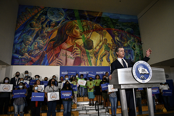 Gov. Gavin Newsom delivers a speech during a rally at the Barrio Action Youth and Family Center, where he would sign the California Comeback Plan relief bill, on July 13, 2021. Pablo Unzueta for CalMatters
