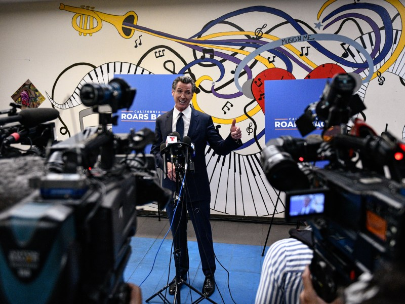 Gov. Gavin Newsom answers questions from the media after a rally where he signed the California Comeback Plan relief bill at the Barrio Action Youth and Family Center in El Sereno, on July 13, 2021. Pablo Unzueta for CalMatters