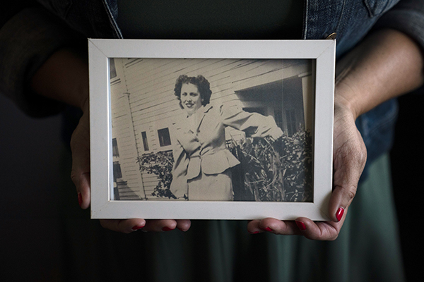 Stacy Cordova, whose aunt was a victim of California's forced sterilization program that began in 1909, holds a framed photo of her aunt Mary Franco on July 5, 2021, in Azusa, Calif. Franco was sterilized when she was 13 in 1934. Franco has since died, but Cordova has been advocating for reparations on her behalf. Photo by Jae C. Hong, AP Photo