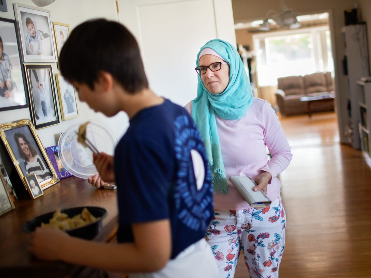 Wendy al-Mukdad talks to her son, Yazan, as he quickly eats some potstickers before his baseball practice on Wednesday, June 23, 2021, in San Bruno- Photo by Dai Sugano, Bay Area News Group