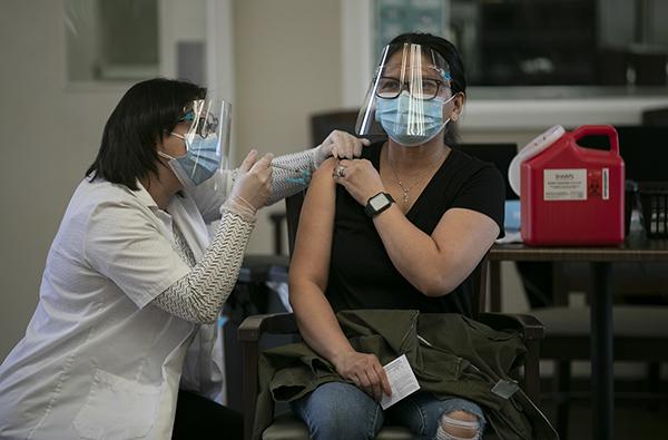 Personal care assistant Riza Green receives a COVID-19 vaccine at Carefield Assisted Living Facility in Castro Valley on Feb. 3, 2021. Photo by Anne Wernikoff, CalMatters