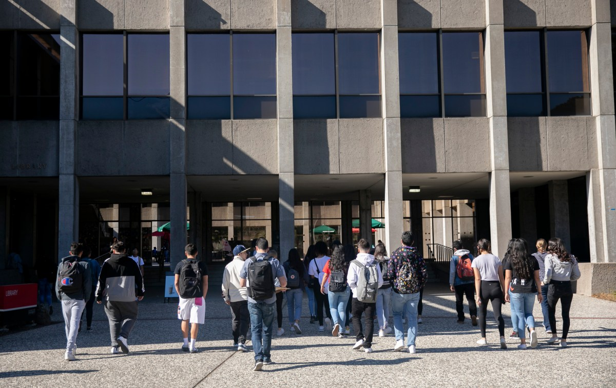 Students walk across campus at California State University East Bay. Photo by Anne Wernikoff for CalMatters