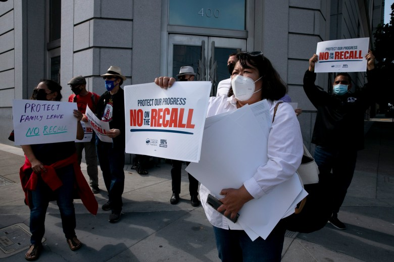 San Francisco Labor Council member Kim Tavaglione, center, participates in a protest against the recall election along with members of various labor groups outside the San Francisco County Superior Court on Aug. 12, 2021. Demonstrators gathered in response to a press event by Rescue California, one of the groups supporting the recall. Photo by Anne Wernikoff, CalMatters