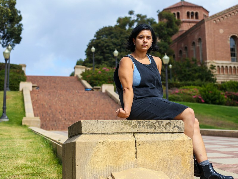 Quinn O'Conner at the Janss Steps on the UCLA campus in Los Angeles on Aug. 18, 2021. O'Conner was diagnosed with Cerebral Palsy when she was 1 years old and is an advocate for disabled UCLA students. Photo by Benjamin Hanson for CalMatters College Journalism Network