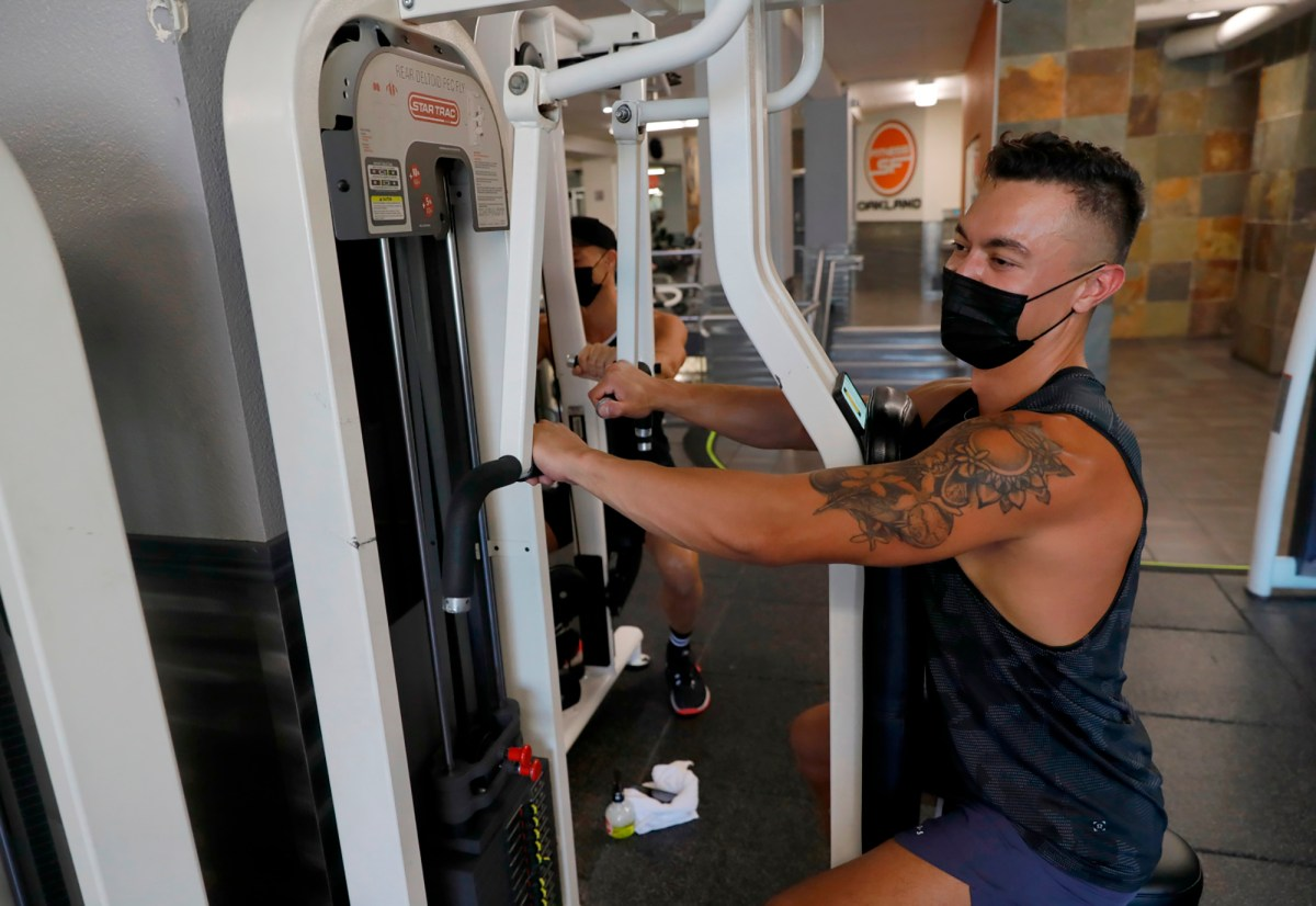Brandon Styles and Will Adams, from right, work out with masks on at Fitness SF in Oakland on August 2, 2021. Bay Area health officers have announced a Bay Area-wide indoor mask mandate, regardless of vaccination status. Photo by Jane Tyska, Bay Area News Group