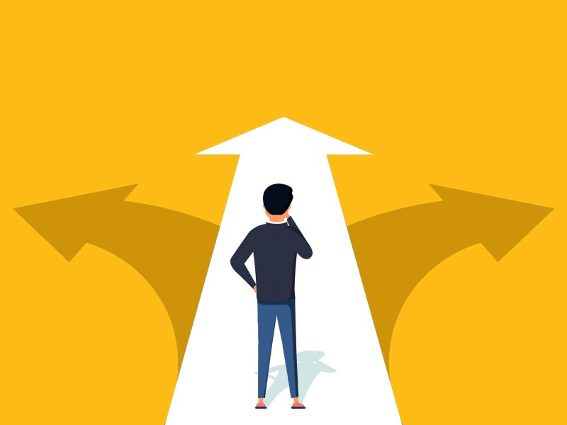 An illustration shows a student standing on an arrow that diverges in three directions. California lawmakers are considering a plan aimed at making it easier for California Community College students to transfer a state four-year campus. Image via iStock