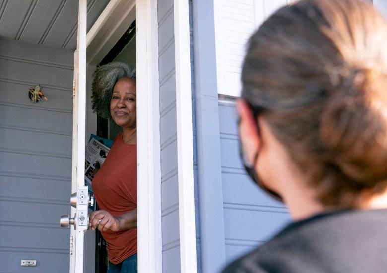 Oakland resident Leta Smith speaks with union volunteer Jennifer Shanoski about the recall Newsom recall.