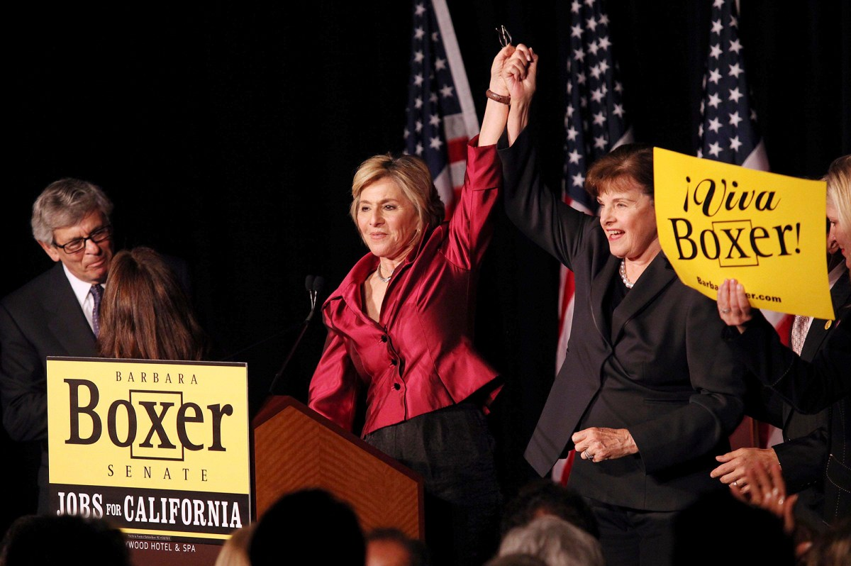 U.S. Sen. Barbara Boxer declares victory in Los Angeles with Sen. Dianne Feinstein after beating Carly Fiorina in 2010. California had two female U.S. senators for more than a quarter century, but has never had a female governor. Photo by Krista Kennell, Sipa Press via AP Images