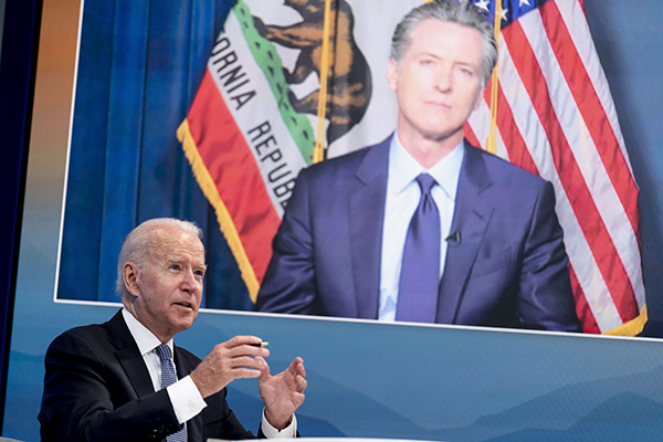 President Joe Biden speaks with California Gov. Gavin Newsom via teleconference during a meeting with governors to discuss ongoing efforts to strengthen wildfire prevention, preparedness and response efforts in Washington on July 30, 2021. Photo by Andrew Harnik, AP Photo
