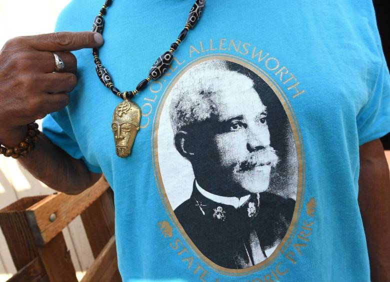 The image of Colonel Allen Allensworth, founder of Allensworth, is displayed on a t-shirt, at the rededication of Allensworth State Historical Park, Wed. Aug. 26, 2021. Photo by John Walker, The Fresno Bee