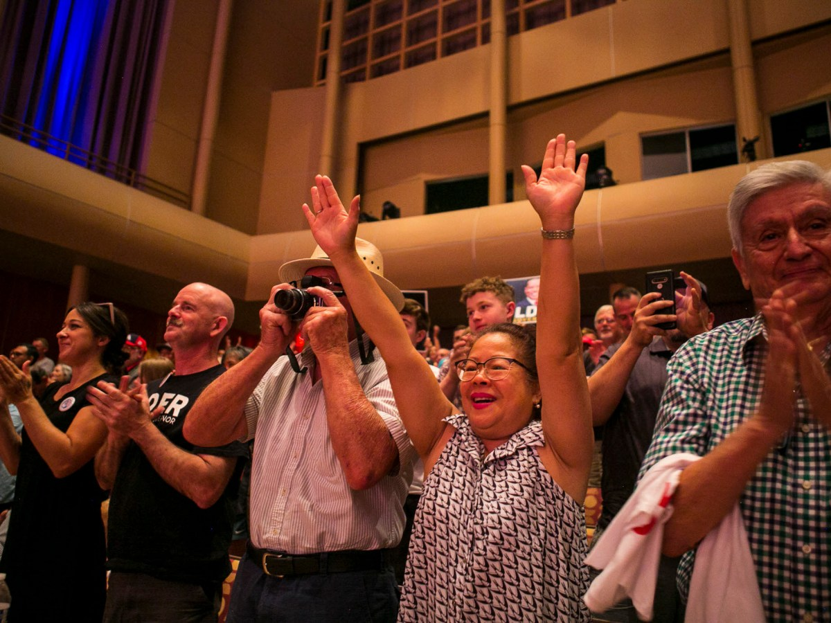 Supporters cheer during a campaign event for Republican recall candidate Larry Elder at the Paul Shaghoian Concert Hall in Fresno on Aug. 22, 2021. Photo by Larry Valenzuela, The Fresno Bee
