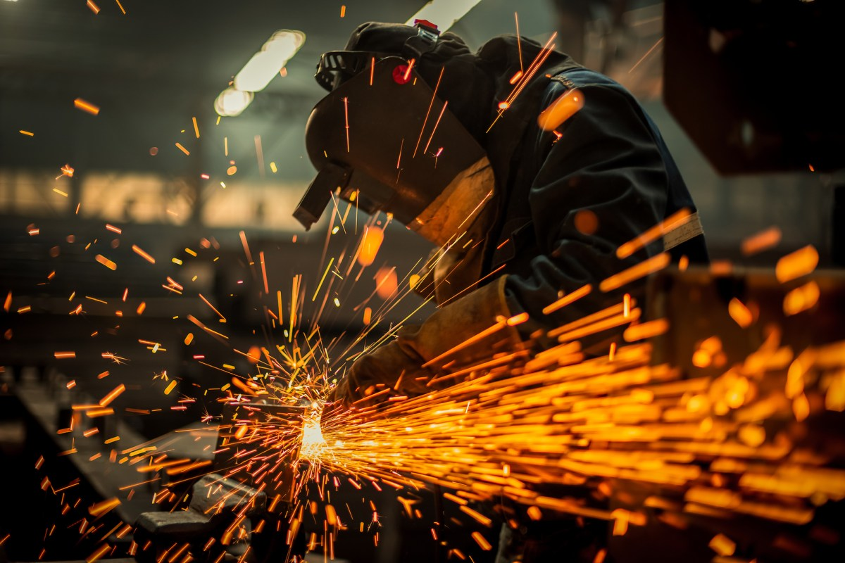 A worker welds. As California attracts higher-educated workers, it is running out of blue-collar labor. Photo via iStock