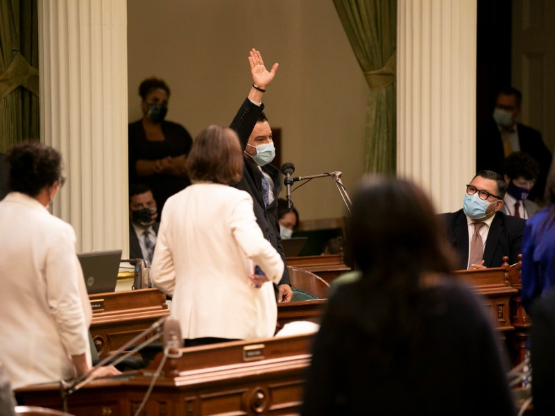 Speaker Anthony Rendon waves to the assembly after the close of the legislative session for the year on Sept. 10, 2021. Photo by Anne Wernikoff, CalMatters