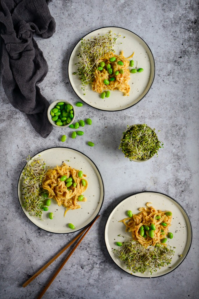 """These quick Paleo """"Peanut"""" Noodles are made from rutabaga and are surprisingly similar to actual noodles. They work beautifully with the cashew and tahini sauce to create a creamy vegan and paleo recipe. Check out this 10 minute recipe! #calmeats #vegan #paleo #whole30 #paleopeanutnoodles #peanutnoodles #paleorecipes #grainfreenoodles #glutenfree #dairyfree #rutabaganoodles #tahinisauce"""