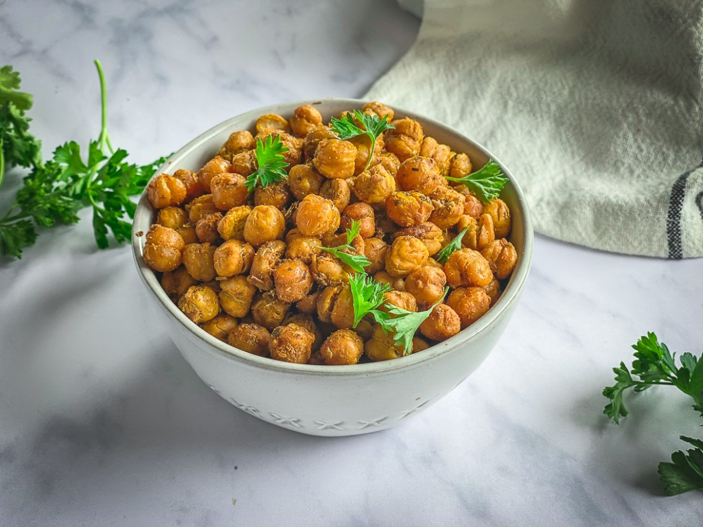 Crispy roasted chickpeas in bowl with parsley
