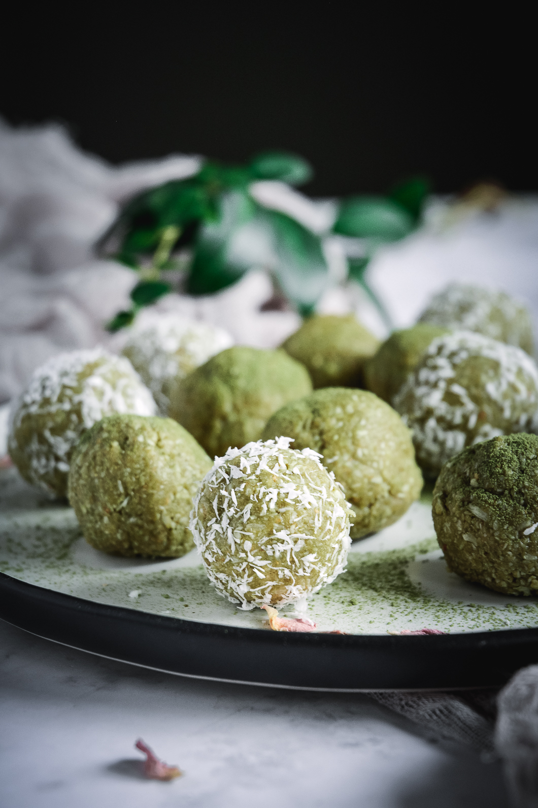 match balls covered with matcha and shredded coconut