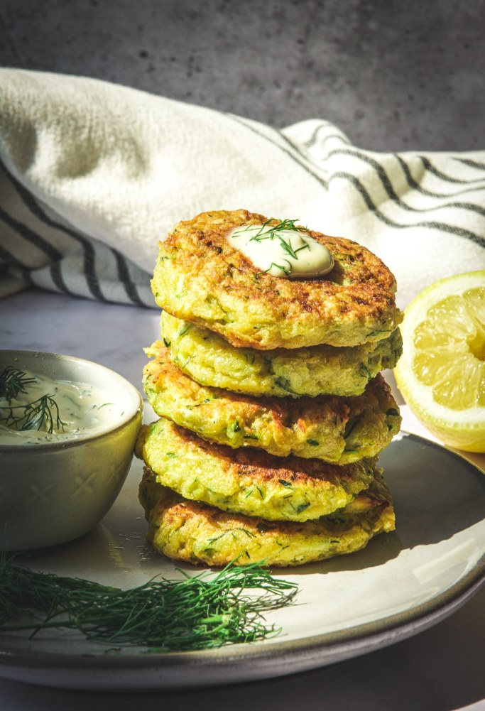 Zucchini Rutabaga Fritters stacked on plate
