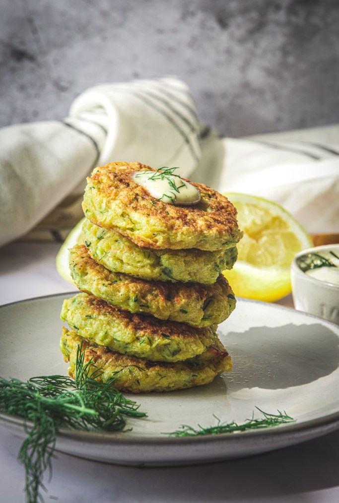 Zucchini Rutabaga Fritters on plate with dill