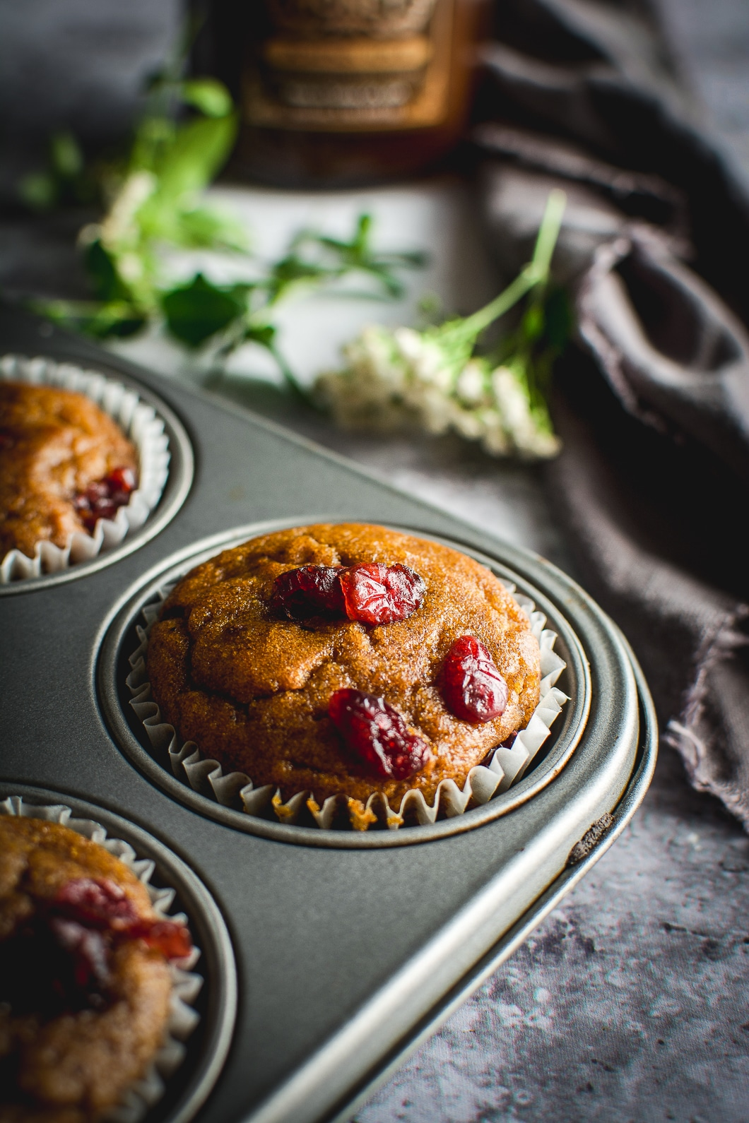 Healthy Grain-Free Cranberry Pumpkin Spice Muffins in tin up close