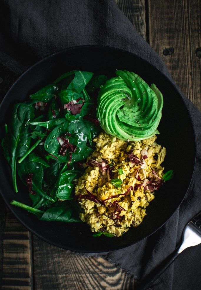 Quick Curried Tuna and Chickpea Salad with Tarragon in bowl with avocado roses and spinach
