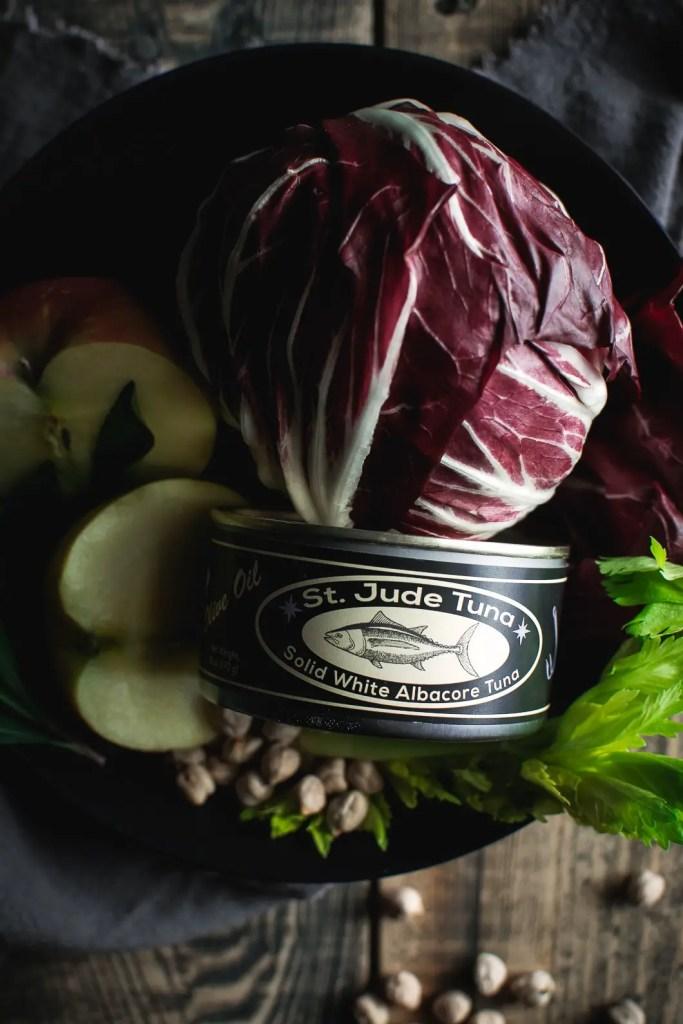Can of tuna, radicchio, apple in bowl