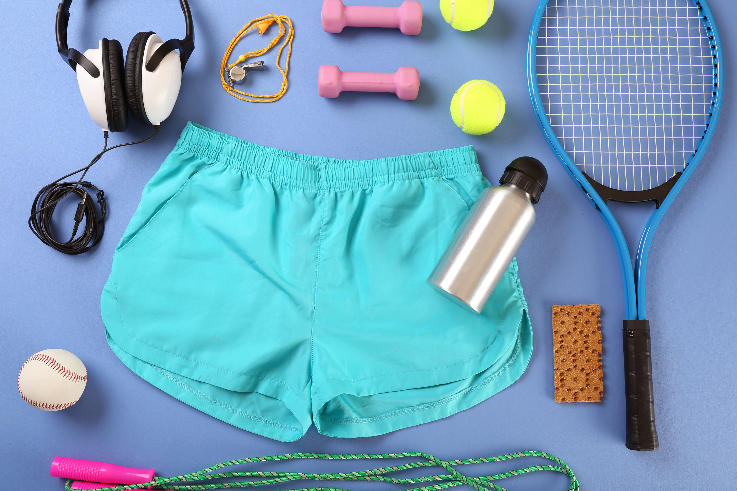 Image of turquoise gym shorts and women's exercise equipment as possible tools for increasing activity levels as described in this post from CALMERme.com