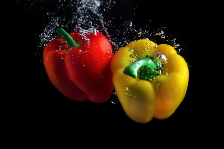 Image of sweet pepper in water depicting the importance of washing your food before eating as discussed in a blog post by CALMERme.com