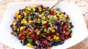 Image shows a dish of black bean and corn salad as described in this recipe on CALMERme.com