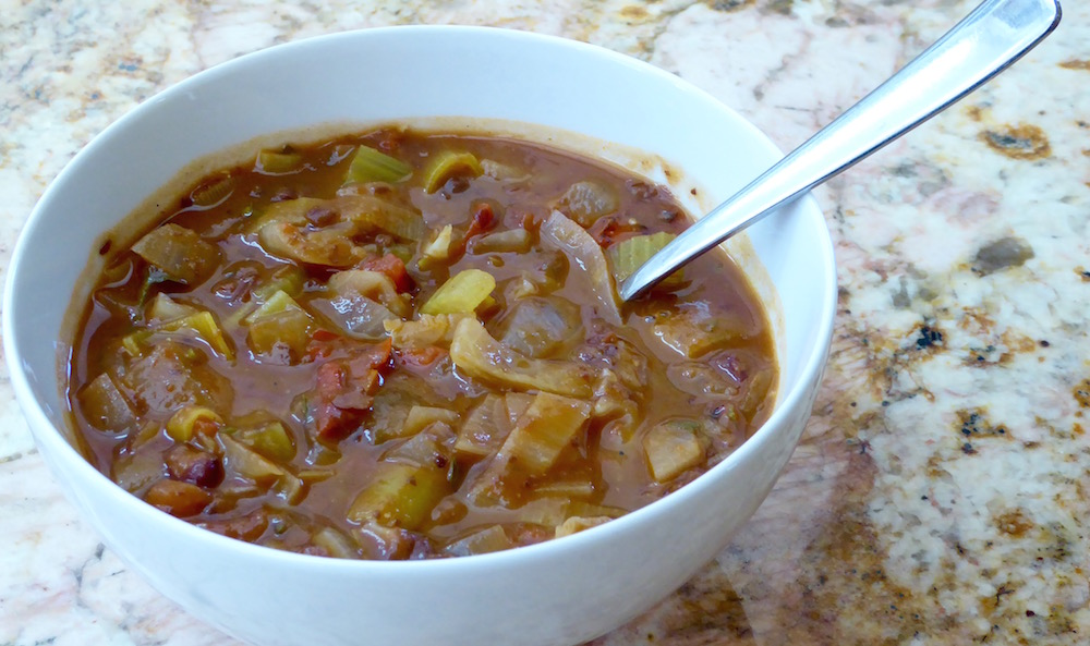 Image shows a bowl of minestrone soup, as described in this recipe on CALMERme.com